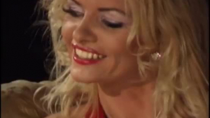 Frisky blonde teen Noir is wearing a red dress while riding her boyfriend's cock