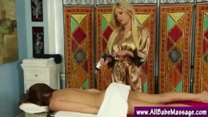 Glamorous masseuse blowing and seducing her client